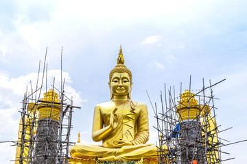 big  golden buddha statue under construction  in thai  temple