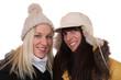 canvas print picture - Zwei lachende Frauen im Winter mit Mütze und Schal