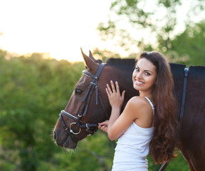 Portrait beautiful woman with long hair next horse