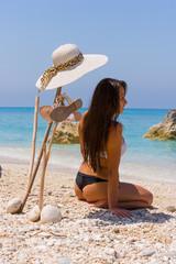 portrait of happy sexy girl in bikini on the beach