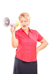 Angry mature lady speaking on a megaphone