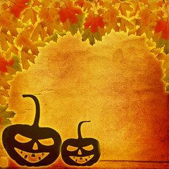 Festive pumpkin Halloween Day on the abstract paper background w
