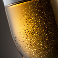 Golden champagne glas with dew