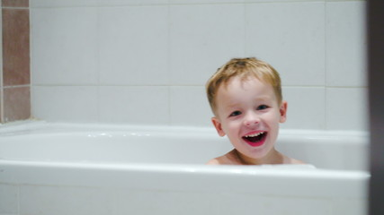 Laughing boy in the bath