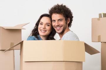 Young Couple Inside Cardboard Box