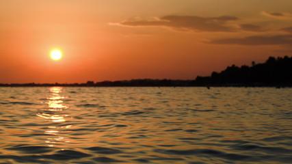 Beautiful sunset over wavy sea
