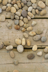 Pebbles  scattered on wood.