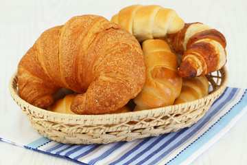 Butter croissants in bread basket, close up