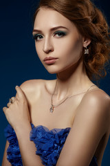 Beautiful girl in a blue evening dress.