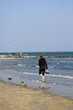 Leinwanddruck Bild - Strandspaziergang