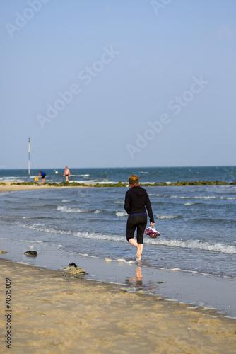 Leinwanddruck Bild Strandspaziergang