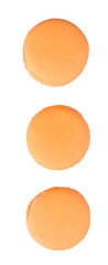 Orange colored French macarons over white background