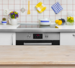 Wooden table on blurred background of kitchen bench