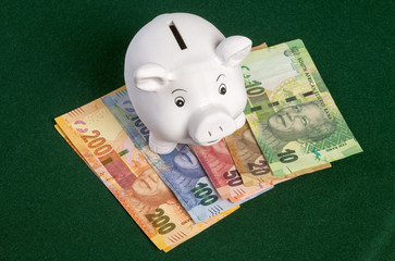 South African Rand and Piggy Bank