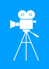 White movie camera on blue background
