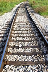 Railroad track through the landscape