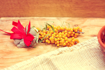 Organic yellow berries of sea buckthorn vintage toning