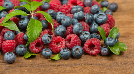 assorted berries on wooden background