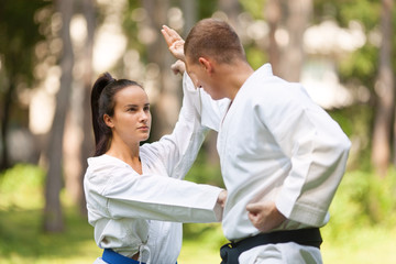 Couple practicing martial arts outdoors