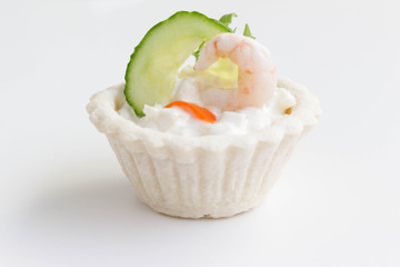 Salt tartlets with shrimps on white background