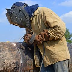 Welder on the pipeline repairs