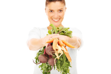 Woman with raw vegetables