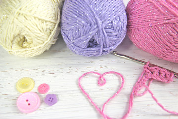 Yarn Wool pastel colours with crochet hook heart and buttons