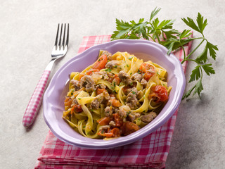 tagliatelle with sausage and fresh tomatoes