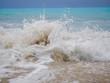 Leinwanddruck Bild - waves breaking on a stony beach