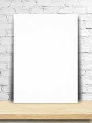 Blank paper poster and brick wall.