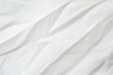 Wrinkle white canvas fabric texture.