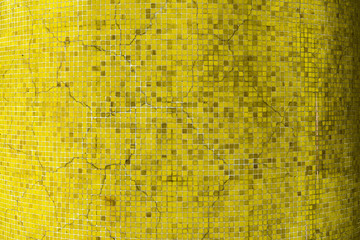 An old yellow crack ceramic tiles wall