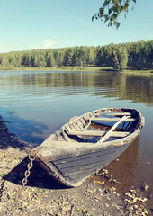 Old wooden boat on the lake