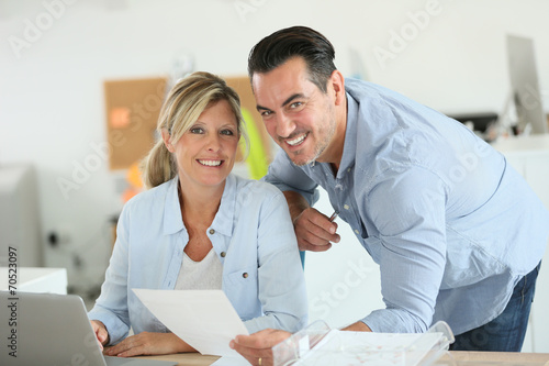 canvas print picture Business people working in office on laptop