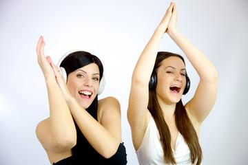 Happy women dancing with headset