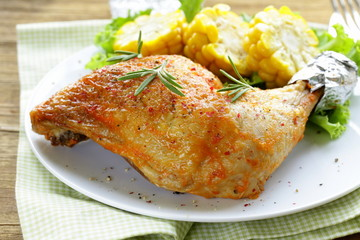 roasted chicken leg with corn for garnish