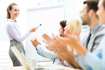 Business people at a presentation, clapping