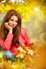 Beautiful woman in autumn park