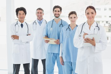 Smiling doctors all standing together