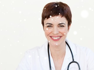 Composite image of beautiful doctor smiling at the camera