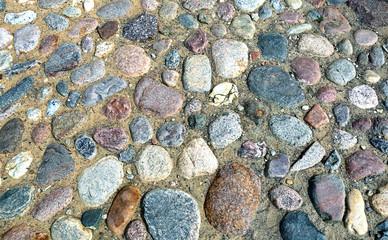 Texture of the pavement of boulders