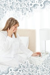 Woman having a headache on her bed