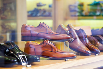showcase with classic male shoes