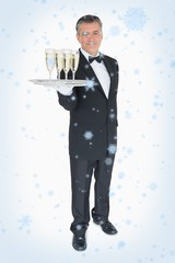 Waiter offering tray with glasses of champagne