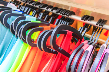 Clothes hang on a shelf, Thailand