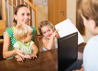 Satisfied family arranging mortgage details