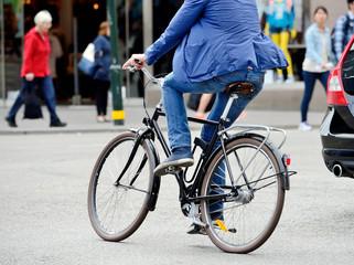 Man on bike in traffic
