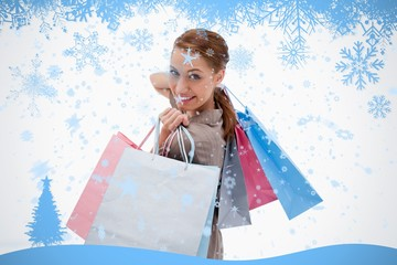 Side view of smiling woman with shopping bags