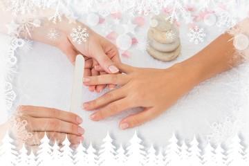 Nail technician filing customers nails