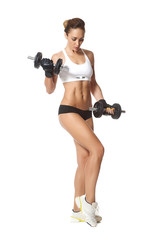 young fit woman lifting dumbbells on white background